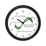 Intrinsic Security shirts, mugs, and a clock.